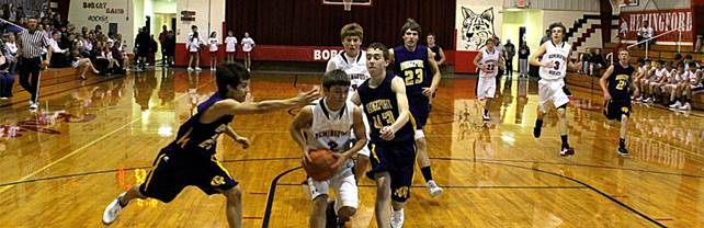 Description: S:\STAFF\cningen\ARC. PIX\BASKETBALL\BOYS BB\BBB 2011-12\BBB vs Bport 2011\Brady and Matt on the drive.JPG
