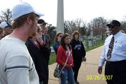 JD Paine our tour guide and bus driver gives the students some of the history of Arlington Semetary